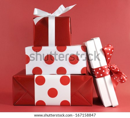 Stack of red and white polka dot theme festive gift box presents for Christmas, Valentine, birthday or Mothers Day occasion. - stock photo