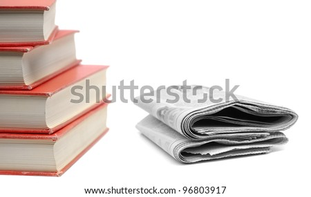 Stack of red books and newspapers isolated on white background - stock photo
