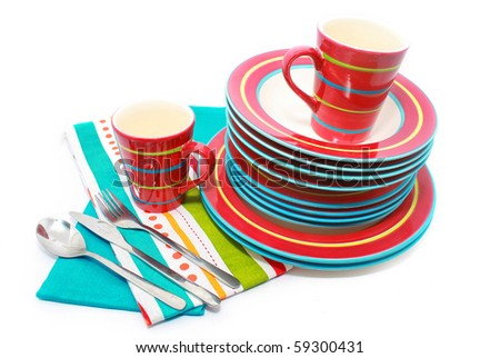 stack of Red ceramic dishes on white background - stock photo