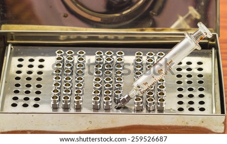 Stack of reuse iron needle No.18G for drug needle and glass syringe in Steam sterilizer - stock photo