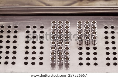 Stack of reuse iron needle No.18 G for drug needle in Steam sterilizer box - stock photo