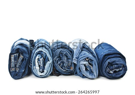 Stack of rolled jeans isolated on white background - stock photo