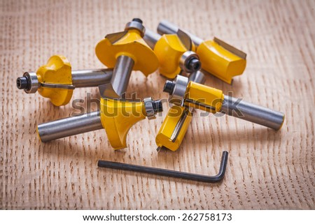 stack of roundover router bits for  woodworking on wooden board  - stock photo