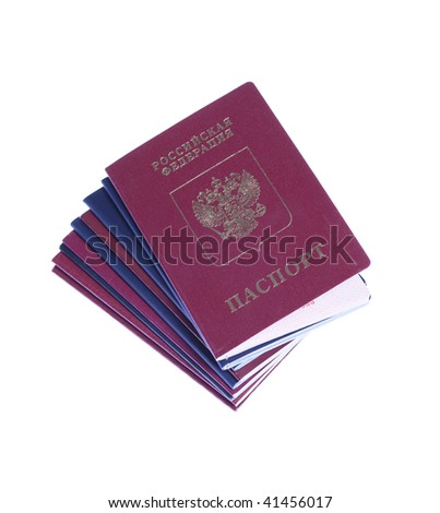 Stack of russian and US passports with russian passport on top - stock photo