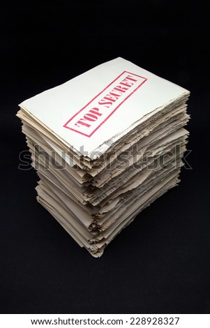 stack of secret documents on a black background - stock photo