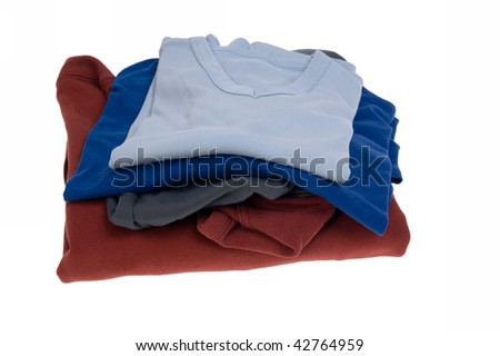 Stack of shirts in different colors isolated on white - stock photo