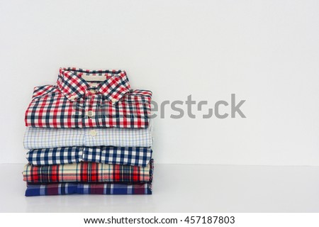 stack of shirts isolated on white, copy space - stock photo