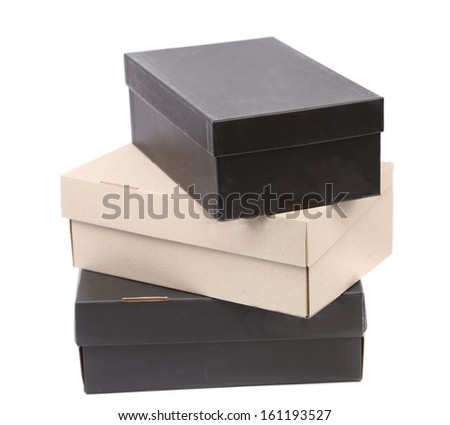 Stack of shoes boxes. Isolated on a white background. - stock photo