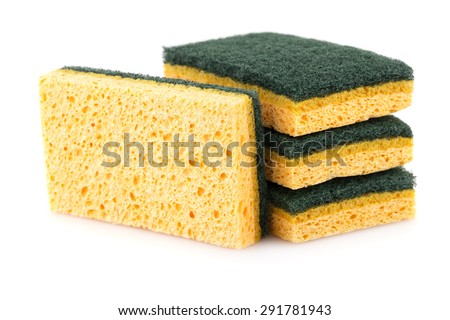 Stack of sponges isolated on white background. - stock photo