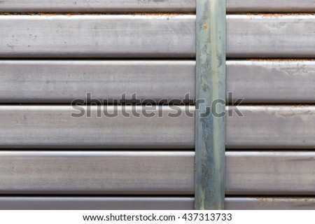 Stack of square bar,The stack of square iron bar in the yard.The stack of iron square bar for construction. - stock photo