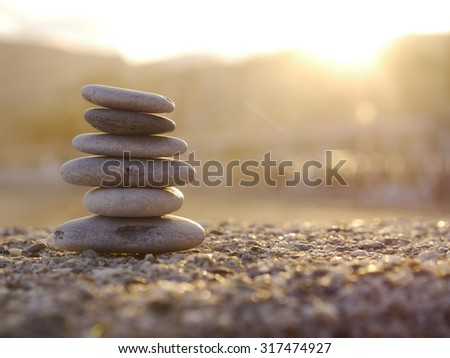 Stack of stones on the beach - stock photo