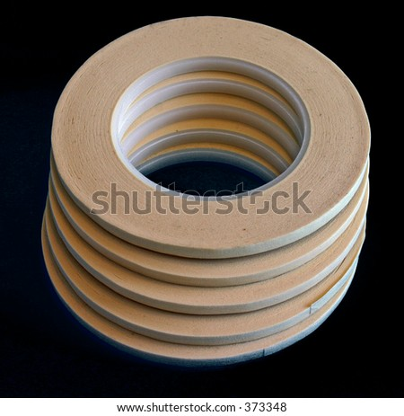 Stack of Thin Rolls of Masking Tape - stock photo