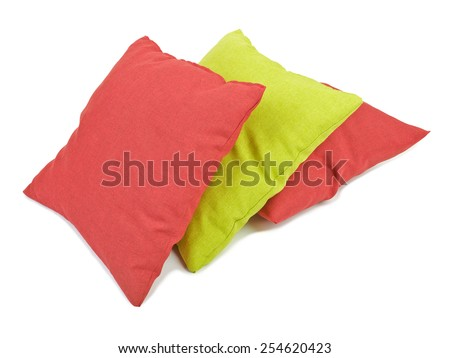 Stack of three cushions or pillows isolated on white background - stock photo