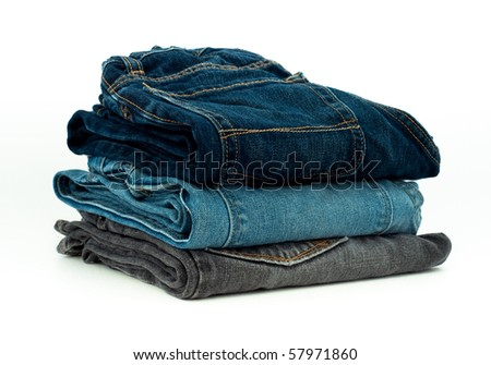 Stack of Three Various Washes Folded Jeans - stock photo