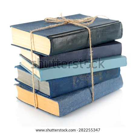 Stack of tied books isolated on white - stock photo