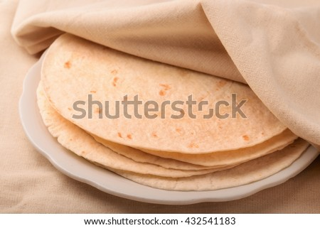 Stack of tortilla covered with neat cloth - stock photo