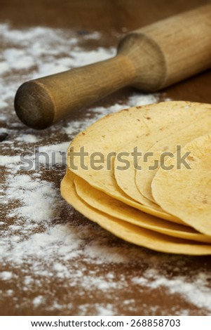stack of tortillas on a wooden background - stock photo