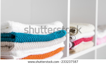 Stack of towels in the linen closet - stock photo