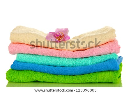 Stack of towels with fragrant flower isolated on white - stock photo