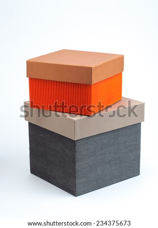 Stack of two closed gift boxes on white background - stock photo