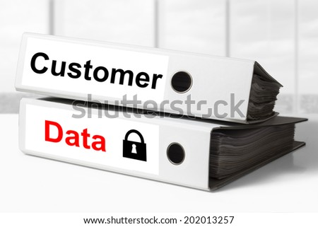 stack of two white office binders customer data security - stock photo