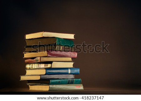 Stack of Used Old Books in the School Library - stock photo