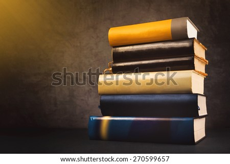 Stack of Used Old Books in the School Library, Toned Cross Processed Image. - stock photo