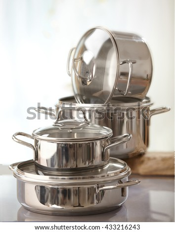 stack of various cooking pots - stock photo