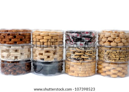 stack of various kinds of pastries in a transparent jar packaging - stock photo