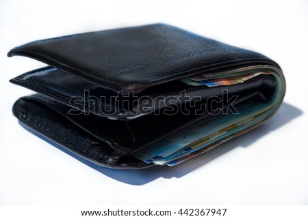 Stack of various of israeli shekel money bills in close black leather wallet. - stock photo