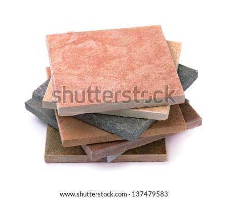 Stack of various stone tiles isolated on white - stock photo