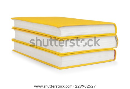 stack of vintage books in a yellow cover on a white background - stock photo