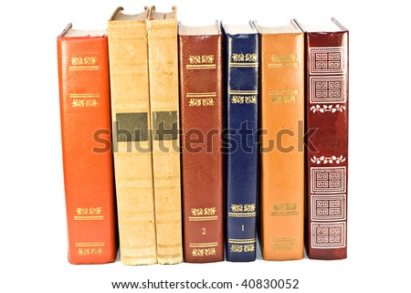 Stack of vintage books isolated on the white background - stock photo