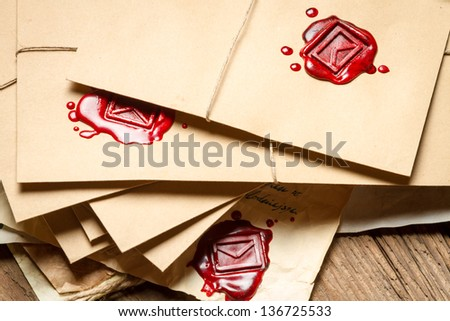 Stack of vintage envelopes with red sealant - stock photo