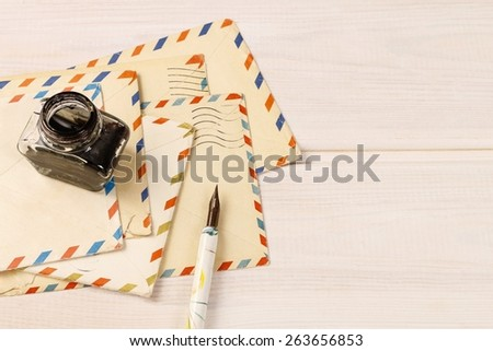 Stack of vintage letters on wooden table - stock photo