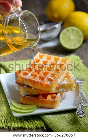 stack of waffles with honey and lemon - stock photo