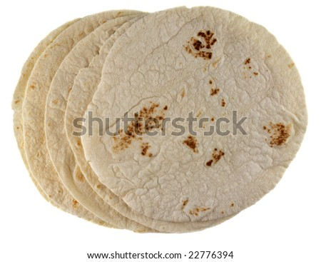 stack of wheat flour tortillas isolated on white - stock photo