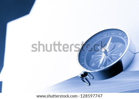 Stack of white cards and compass - stock photo