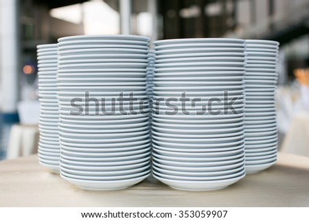 Stack of white ceramics plate - stock photo