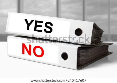 stack of white office binders yes no - stock photo