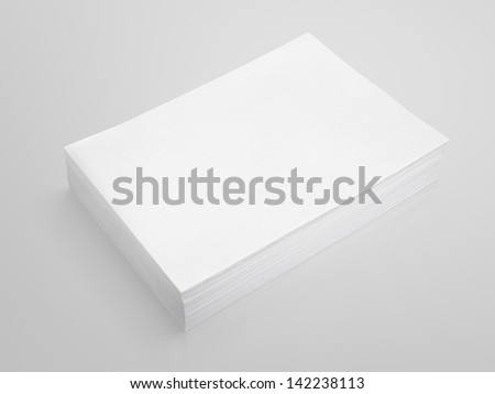 Stack of white paper on gray background with clipping path - stock photo