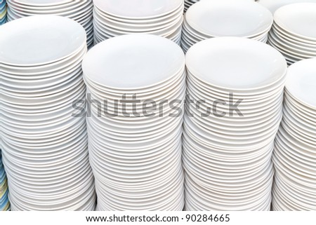 stack of white plates - stock photo