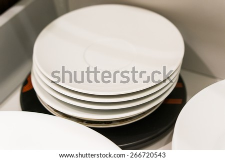 Stack of white plates in drawer - stock photo