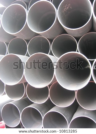Stack of white pvc drain field pipe. - stock photo