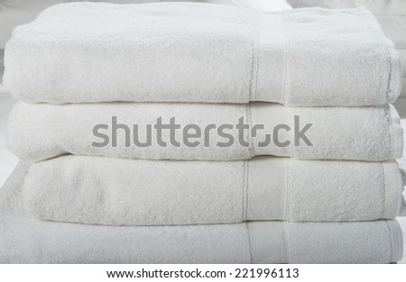Stack of white spa towels.  Stack of white spa towels folded on top of each other. - stock photo