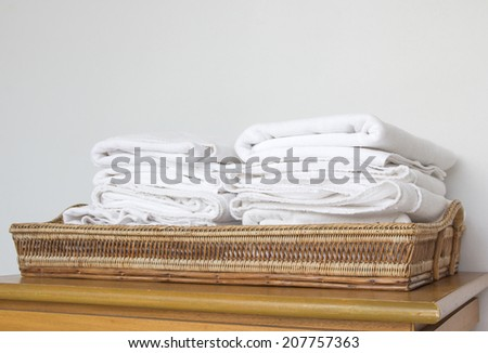 stack of white towel on basket - stock photo