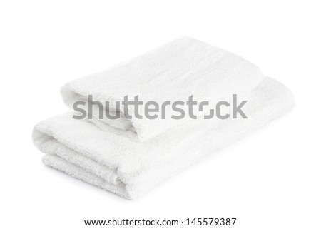 stack of white towels isolated on white - stock photo