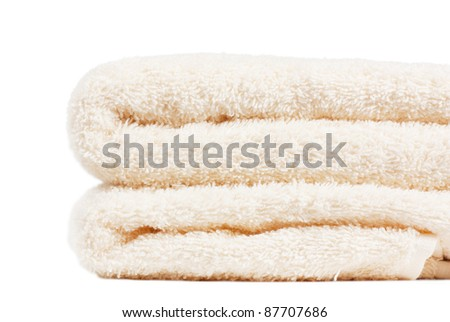 Stack of white towels over white background - stock photo