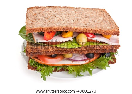 stack of whole wheat bread sandwiches with meat and vegetables - stock photo