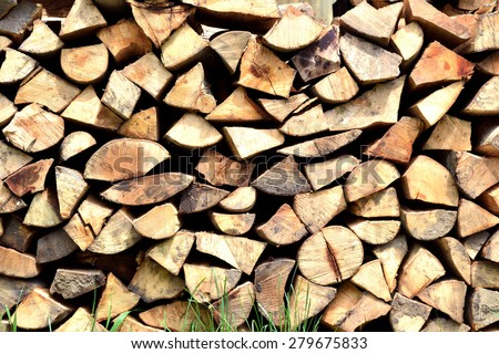 stack of wood firewood  background  - stock photo